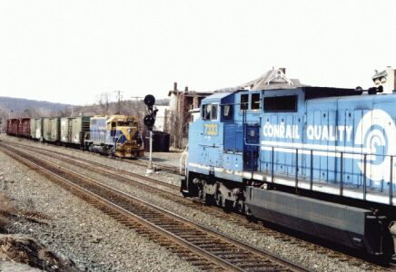 CSX freight Q427 meets NECR interchange run at Palmer.  Photo taken April, 2002